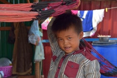 Cambodian boy in the village of Tonle Sap
